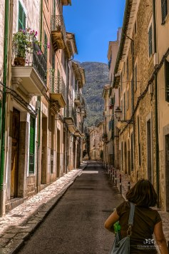 Woman walking in alley at Soller, Mallorca